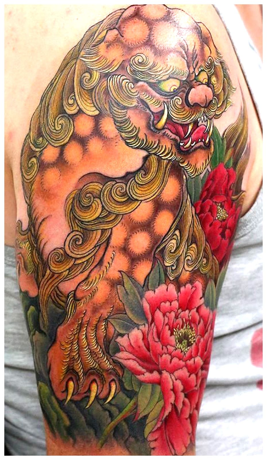 Colorful foo dog tattoo sleeve