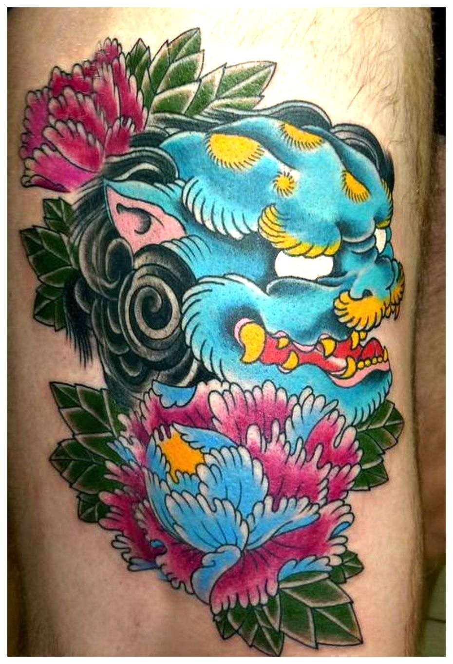 foo dog tattoo inner arm